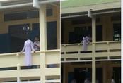 Thi gan với tử thần, nữ sinh vô tư ngồi quay lưng ngoài lan can lớp học ở tầng 1 khiến cư dân mạng thót tim