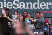 Cô gái ngực trần gây náo loạn cuộc vận động tranh cử Tổng thống ở Mỹ