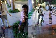 Mẹ độc thân dùng xích trói con vào xe đạp