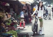 Trương Ngọc Ánh diện áo dài tuyệt đẹp, cưỡi xe cub đi chợ