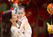 Maya lần đầu bế con gái dạo chơi trên phố Hà Nội