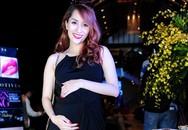Khánh Thi ôm bụng bầu 6 tháng tại sự kiện