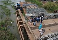 Tìm thấy thi thể cô gái rớt xuống sông khi qua cầu tạm