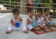 Cặp vợ chồng rớt nước mắt nói về 4 con gái cùng ngày sinh