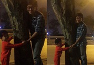 Chùm ảnh bố cùng con trai thắt nơ bảo vệ cây gây xúc động