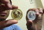Mừng tuổi tờ 100 USD bằng vàng thật