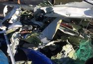 Ngư dân vớt được ví tiền và nhiều mảnh vỡ nghi của máy bay CASA