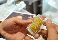USD bật tăng, vàng SJC giảm dè dặt