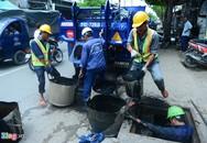 Nghề lặn ngụp trong nước thải ống cống ở Sài Gòn