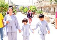 Thúy Nga đưa con gái lên chùa làm từ thiện