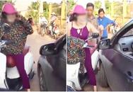 """Cô gái cởi áo, chửi lái xe ô tô như """"tát nước"""" rồi xông vào đánh nhau vì bị nhắc nhở khi đứng giữa đường nghe điện thoại"""