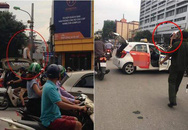 """Tài xế taxi leo lên nóc xe """"ăn vạ"""" khi bị CSGT Hà Nội dừng xe"""