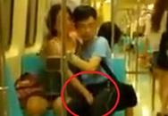 Cặp đôi thản nhiên mơn trớn nhau trên tàu