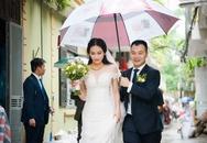 Á hậu Đại dương 2014 được chồng hơn 9 tuổi che mưa trong lễ rước dâu