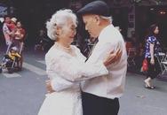Hình ảnh cô dâu tóc bạc mặc váy cưới trắng, chú rể chống gậy móm mém cười khiến trên phố Hà Nội gây sốt mạng
