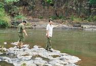 Phát hiện thi thể người phụ nữ kẹt trong khe đá dưới sông