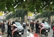 """Nam thanh niên túm tóc, đấm túi bụi vào người bạn gái trên phố Hà Nội rồi phân bua """"Nó láo"""""""
