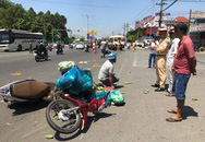 6 người đi xe máy dừng đèn đỏ bị ôtô khách hất văng