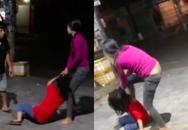 Thấy vợ lao vào túm tóc, đập đầu nhân tình xuống đường, người chồng can ngăn không được liền phóng ô tô bỏ đi