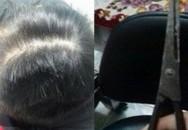 Bất chấp con trai 10 tuổi đứng trước mặt, chồng vẫn đánh đập và cắt trọc đầu vợ