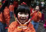 Loạt ảnh trẻ em HN chào đón hội nghị thượng đỉnh Mỹ-Triều lên báo Hàn Quốc