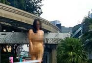 Cô gái chuyển giới khỏa thân nhảy múa trên phố Kuala Lumpur