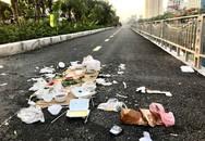 Đống bát đũa xốp, túi nilon cùng đồ ăn thừa bị bỏ lại trên đường đi bộ ven bờ sông Tô Lịch khiến nhiều người phẫn nộ