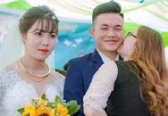 Bức ảnh cưới gây 'bão' mạng xã hội: Cô gái vô tư hôn chú rể trong ngày cưới, cô dâu đứng cạnh mặt không cảm xúc