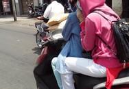 Phụ nữ Sài Gòn che kín tránh nắng như giữa sa mạc