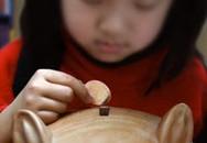 5 cách dạy trẻ sai lầm về tiền bạc
