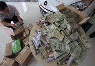 Mua ô tô 600 triệu trả bằng 10 thùng carton… tiền lẻ