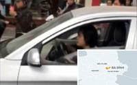 Nữ tài xế lái ôtô đẩy cảnh sát giao thông đi hơn trăm mét trên phố