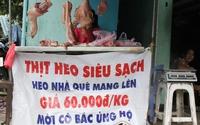 Người nuôi heo Đồng Nai trải bạt bán thịt giá rẻ đầy đường Sài Gòn