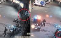 Cảnh sát dùng thân mình đỡ thiếu phụ nhảy lầu tự tử