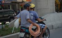 Nắng nóng đỉnh điểm ở Hà Nội, thợ điều hòa kiếm tiền triệu mỗi ngày