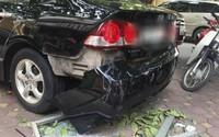 Hà Nội: Cửa kính chung cư bất ngờ rơi xuống đất làm hỏng xe ô tô, nhiều người ngồi trà đá may mắn thoát nạn