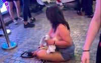 Bị khiêng ra khỏi quán, khách nữ lột đồ rồi khóc nức nở giữa phố cổ Tạ Hiện