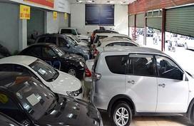 Đại gia ôtô lỗ nặng: Đóng showroom đi bán nước ngọt, quần áo