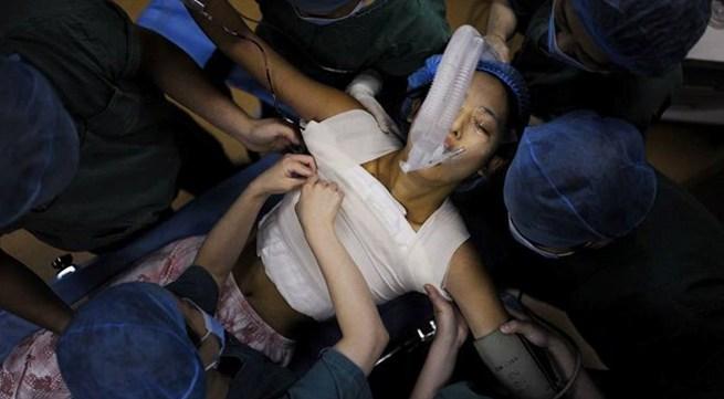 Nữ sinh quyết nâng vòng một để thi người mẫu ngực