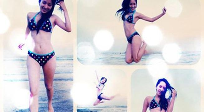 """Khánh Thi tái xuất với bikini sau tin đồn """"mất tích"""""""