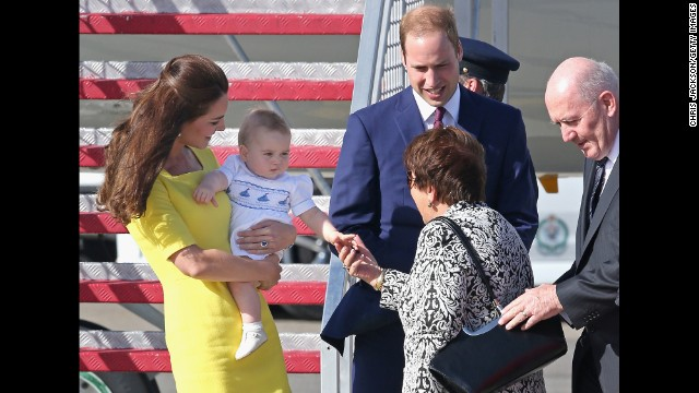 George shakes hands with Lynne Cosgrove, the wife of Australias governor-general, on the tarmac of Sydney Airport on April 16.