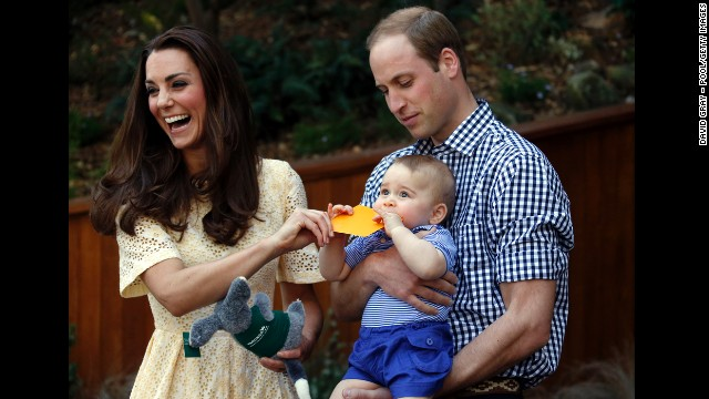 Catherine and William react as their son bites a small present at the bilby enclosure of Sydneys Taronga Zoo on April 20. One of the zoos bilbies was renamed George in honor of the young prince.
