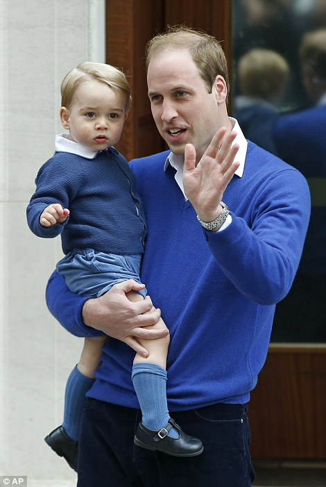The young royal offers a shy wave to the waiting photographers