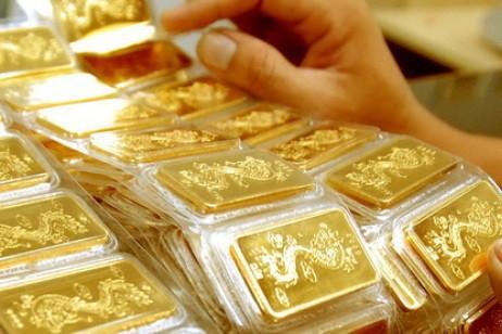 Chọn mua vàng ngày vía Thần Tài là thói quen của nhiều người. Ảnh minh họa.