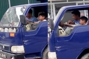 Hình ảnh cháu bé 10 tuổi lái xe tải trên phố