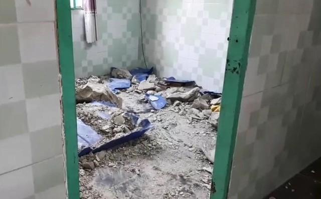 Hiện trường bên trong căn nhà nơi phát hiện thi thể bị đổ bê tông.