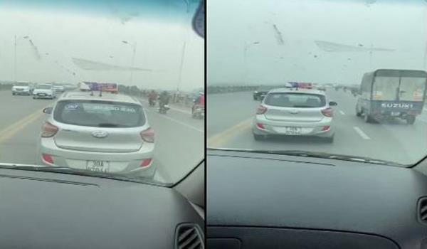 Tài xế taxi nghênh ngang cản đường xe cấp cứu trên cầu Vĩnh Tuy - Ảnh 1.