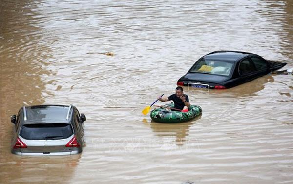 Lũ lụt tang thương ở Trung Quốc: 141 gười chết, di sản cầu cổ 800 năm tuổi bị phá hủy - Ảnh 7.