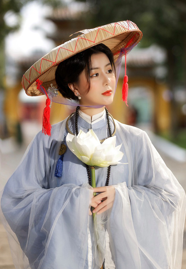 دختر داغ از مدرسه HUFLIT به عنوان یک رویا با پیراهن سنتی Tac زیبا است - تصویر 9.
