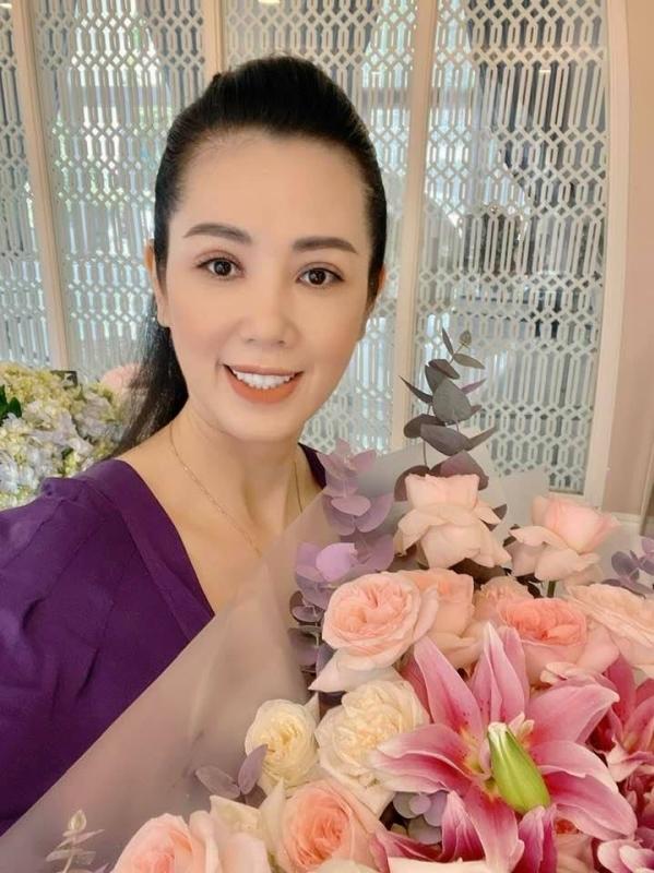 Nhan sắc á hậu Vi Thị Đông tuổi 46 - Ảnh 4.